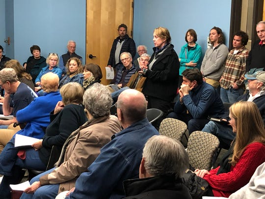 Karen Knab addresses the group of concerned neighbors who gathered Jan. 28 at Skyland Public Library to discuss a proposed 80-unit town home apartment complex proposed for Overlook Road.