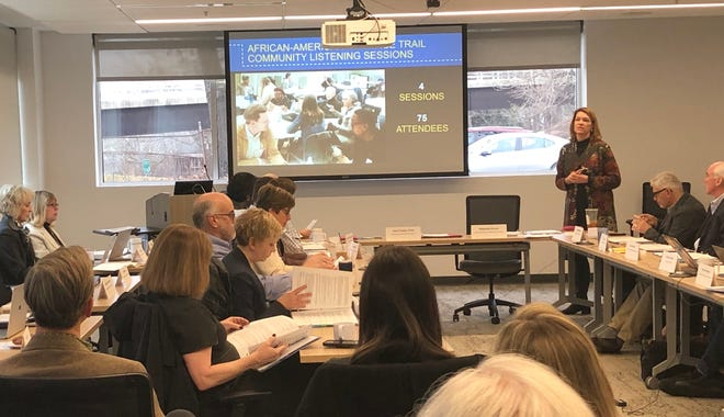Stephanie Brown, standing, addresses the meeting of the Buncombe County Tourism Development Authority board on Jan. 29. The authority approved supplemental spending of $1.1M for marketing purposes this spring and summer.