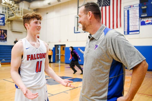 Ben Bryson talks to his father, Joey, following West Henderson's win over Erwin January 28, 2020 in Hendersonville.