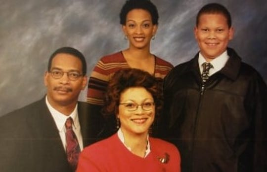 An undated photo of Carlos Showers with wife Sheila Showers, son Alex Showers and daughter Kisha Showers-Griffin.