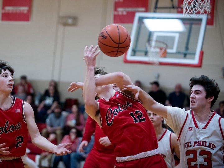 St. Philip senior Charlie Harrington (23) knocks the ball from Colon junor LaWayne Wickey (12) on Tuesday, Jan. 28, 2020 at St. Philip High School in Battle Creek, Mich.