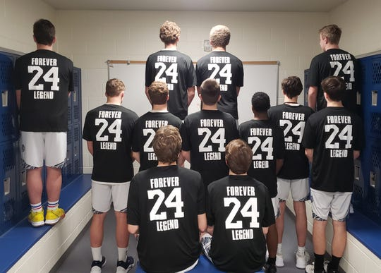 The Gull Lake boys basketball team pays tribute to the late Kobe Bryant prior to the Blue Devils' game against Portage Central on Tuesday.
