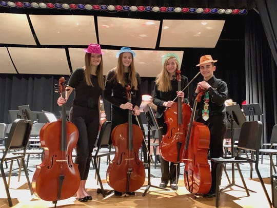 Karson Smith (far left, in pink hat) is a junior at Vestal High School. She will perform the cello at Carnegie Hall with the High School Honors Symphony Orchestra.