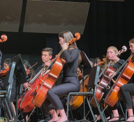Karson Smith (center) is a junior cello player at Vestal High School. She will perform at Carnegie Hall with the High School Honors Symphony Orchestra on Sunday.