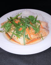 Guang Dong Style Snapper, snapper steamed with garlic, ginger, cilantro, soy and sesame oil, is on the menu for Thursday's Chinese International Dinner at Florida Tech's Panther Dining Hall.
