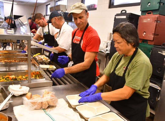 Workers and volunteers prepare meals Wednesday at the Brevard Community Kitchen in Rockledge. The food going out to Meals on Wheels and Seniors at Lunch site is funded in part through federal funding, money affected by U.S. Census results.