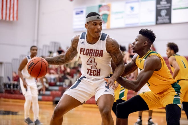Florida Tech senior Derek Murphy posts up a Saint Leo defender during a game Jan. 25, 2020, at the Clemente Center in Melbourne, Fla.