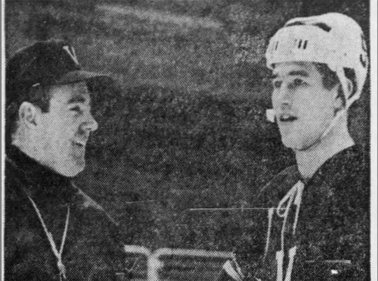 Vermont men's hockey coach Jim Cross speaks to a player during this undated photo from the Free Press archives.