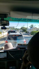 Traffic backs up on the Grand Cayman Island after a 7.7 earthquake forces residents to flee the beach and head to safety on Tuesday, Jan. 28.