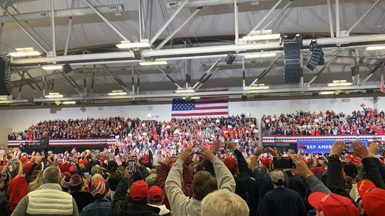 Trump supporters are ready to snap a photo of the president when he comes to the podium at the Wildwoods Convention Center on Jan. 28.