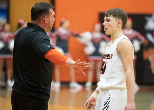 Waverly head coach Travis Robertson talks to son Trey Robertson during a 68-63 win over Minford on Jan. 28, 2020 in Waverly.
