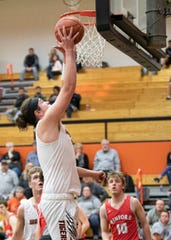 Waverly's Tanner Smallwood goes up for a layup during a 68-63 win over Minford on Jan. 28, 2020, in Waverly, Ohio.