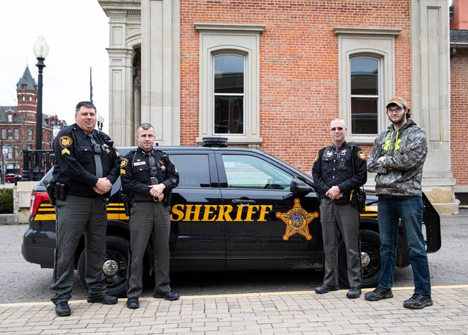 (L-R) Sergeant Lawhorn, Sergeant Steele, Deputy Montgomery, and Jonathan stand outside the Ross County Law Enforcement Complex on Jan. 29, 2020. The officers were able to help Jonathan, who was living on disability, with clothing, groceries, and a bicycle for transportation and connect him to the Pioneer Center for future aid.