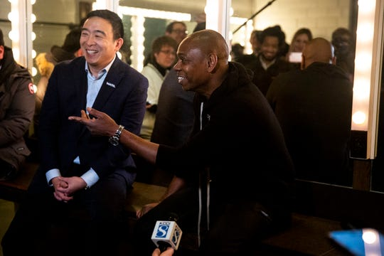 Andrew Yang, Democratic presidential candidate, and Comedian Dave Chappelle answer questions from the press before Chappelle's performance, on Tuesday, Jan. 28, 2020, at Stephens Auditorium in Ames, Iowa. Chappelle spoke to the press about why he's endorsed Yang.
