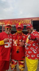Hand out photo of Kansas City Chiefs fan Charlie Edrington (center) and friends at a Chiefs game.