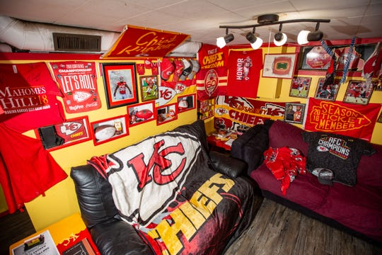 The basement of Charlie Edrington's house in Des Moines is devoted to the Kansas City Chiefs.