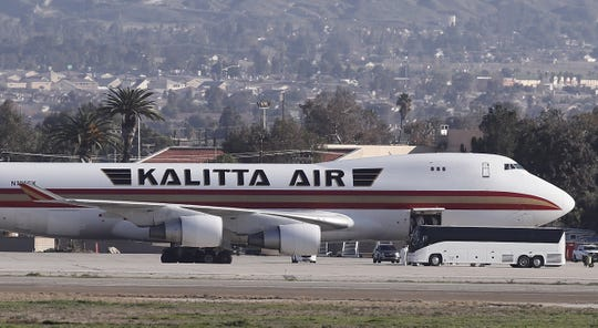 Personnel in hazmat suits are seen in the cargo hold of the Kalitta Air Boeing 747-400 freighter at the March Air Reserve Base after deplaning 200 American evacuees in Riverside, California Jan. 29, 2020. The plane left Wuhan, epicenter of the coronavirus epidemic, to Anchorage, Alaska, to refuel and screen the passengers before departing for March Air Reserve Base where the evacuated U.S. citizens will be taken care of by the CDC.