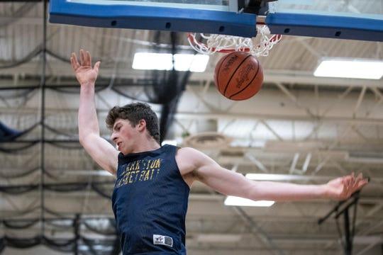 Clarkston's Matt Nicholson makes a dunk during practice at Clarkston High School on Tuesday, Jan. 28, 2020.