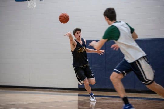 Clarkston's Matt Nicholson practices with teammate at Clarkston High School on Tuesday, Jan. 28, 2020.