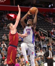 Detroit Pistons forward Sekou Doumbouya (45) drives against Cleveland Cavaliers forward Kevin Love (0) during third period action Monday, January 27, 2020 at Little Caesars Arena in Detroit, Mich.