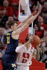 Nebraska's Haanif Cheatham (22) is guarded by Michigan's Franz Wagner (21) during the second half of an NCAA college basketball game in Lincoln, Neb., Tuesday, Jan. 28, 2020. Michigan won 79-68. (AP Photo/Nati Harnik)