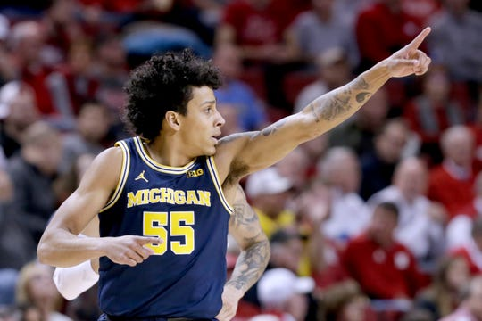 Michigan's Eli Brooks (55) celebrates after scoring a 3-point shot during the first half of an NCAA college basketball game against Nebraska in Lincoln, Neb., Tuesday, Jan. 28, 2020. (AP Photo/Nati Harnik)