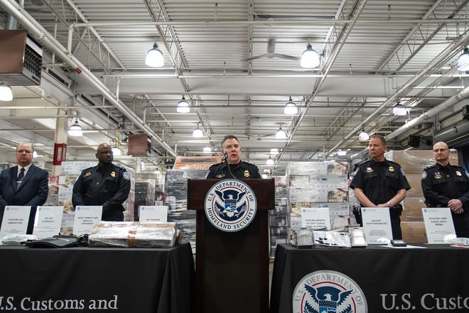 Christopher Perry, Director Field Operations at U.S. Customs and Border Protection, talks with media members while going over items confiscated from people crossing into the U.S. from Canada during a press conference at the CBP Fort Street Cargo Facility in Detroit on Wednesday, January 29, 2020.