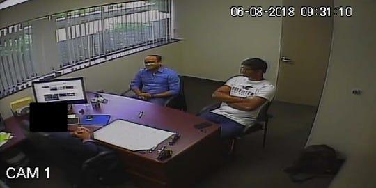 Phanideep Karnati (in blue) sits next to co-conspirator Santosh Sama, right, during a secretly recorded meeting at the University of Farmington.