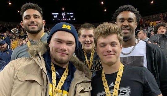Football recruiting targets Giovanni El-Hadi, Rocco Spindler, Garrett Dellinger, Donovan Edwards, and J.J. McCarthy attend Michigan's basketball game Saturday against Illinois.