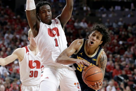 Michigan's Eli Brooks drives to the basket past Nebraska's Kevin Cross during the second half.