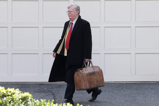 Former National security adviser John Bolton leaves his home in Bethesda, Md. Tuesday.