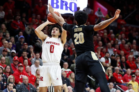 Rutgers guard Geo Baker (0) shoots as Purdue guard Nojel Eastern (20) defends during the second half.
