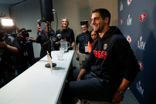San Francisco 49ers quarterback Jimmy Garoppolo smiles as he speaks during media availability Tuesday for the Super Bowl.