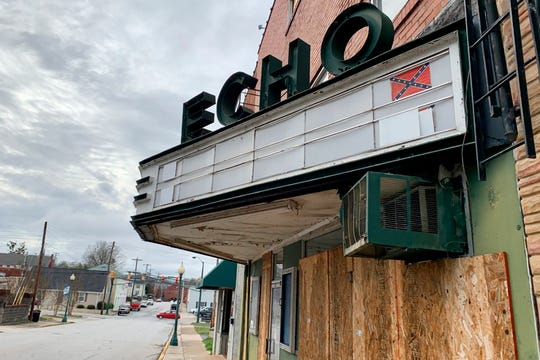 """In this Monday, Jan. 13, 2020 photo, reminders of """"The Redneck Shop"""" are still on display on the Echo Theater's marquee, in Laurens, S.C. The building was used as a meeting place for members of the Ku Klux Klan."""