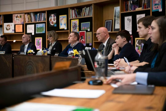 Saline Area School Board members listens as students and parents voice their concerns in regards to racist Snapchat messages sent by Saline High School students during a Saline School board meeting.