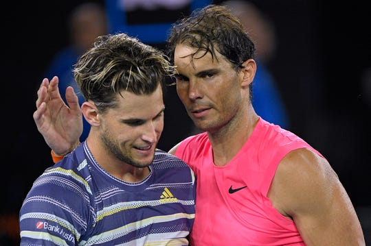 Austria's Dominic Thiem, left, is congratulated by Spain's Rafael Nadal after winning their quarterfinal match at the Australian Open.
