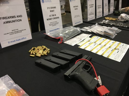 A pistol, magazines and ammunition seized by federal agents last year