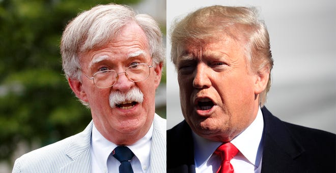 Former national security adviser John Bolton, left, and President Donald J. Trump