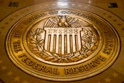 This Feb. 5, 2018, file photo shows the seal of the Board of Governors of the United States Federal Reserve System at the Marriner S. Eccles Federal Reserve Board Building in Washington.