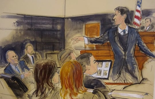 In this courtroom sketch, defense attorney Howard Srebnick, second from right, points to his client Michael Avenatti, far left, as he makes opening remarks during trial in New York, Wednesday Jan. 29, 2020.