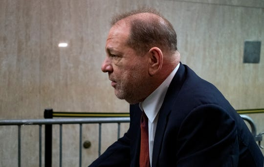 Harvey Weinstein leaves for the day during his trial on charges of rape and sexual assault, Tuesday, Jan. 28, 2020 in New York.
