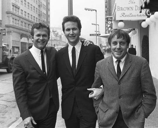 In this Jan. 31, 1967, file photo, members of the Kingston Trio, from left: Bob Shane, John Stewart and Nick Reynolds are pictured in the Hollywood section of Los Angeles. Shane, the last surviving original member of the popular folk group the Kingston Trio, died Jan. 26, 2020, in Phoenix. He was 85.