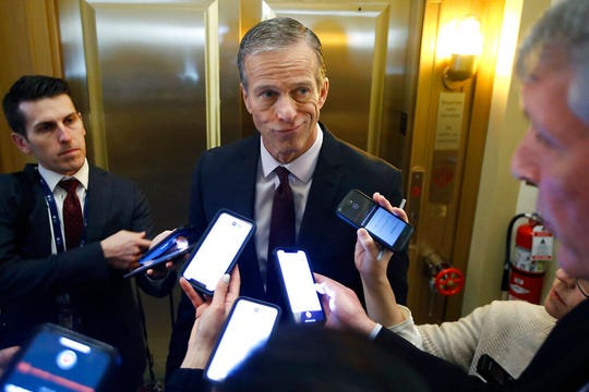 Sen. John Thune, R-S.D., answers reporters questions outside his office prior to the start of the impeachment trial Wednesday Jan 29, 2020, in Washington.