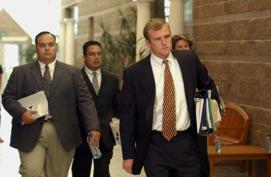 In this Oct. 9, 2003, file photo, District Attorney Mark Hurlbert, right,  Eagle County Sheriff's Detective Doug Winters, left, and Deputy District Attorney Gregg Crittenden rear, members of the team prosecuting Los Angeles Lakers star Kobe Bryant on sexual assault charges, enter the court for a preliminary hearing  at the Justice Center in Eagle, Colo.