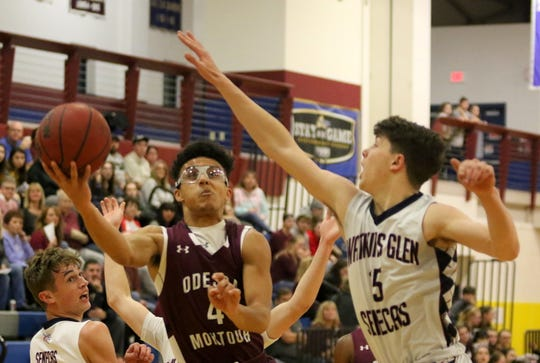 Preston Harris of Odessa-Montour tries to get off a shot as Watkins Glen's Adam Pastore defends during the Senecas' 80-36 win in boys basketball Jan. 28, 2020 at Watkins Glen High School.