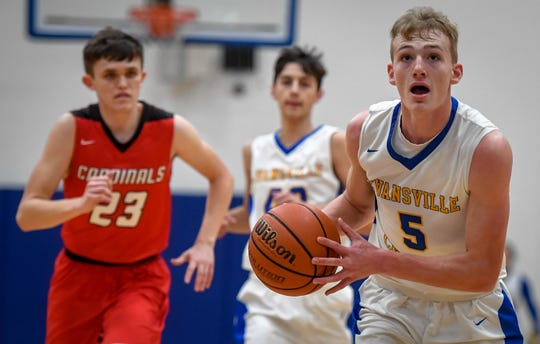 Evansville Christian's Hunter Lindsey (5) drives to the basket on a breakaway layup as the Evansville Christian Eagles plays the Washington Catholic Cardinals in Evansville Tuesday evening, January 28, 2020.