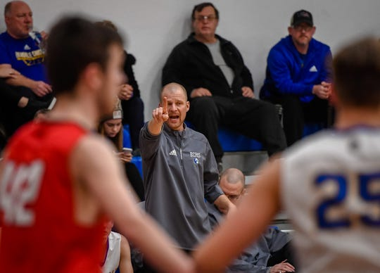 Evansville Christian head coach Aaron Thompson shouts instructions to his team as the Evansville Christian Eagles plays the Washington Catholic Cardinals in Evansville Tuesday evening, January 28, 2020.