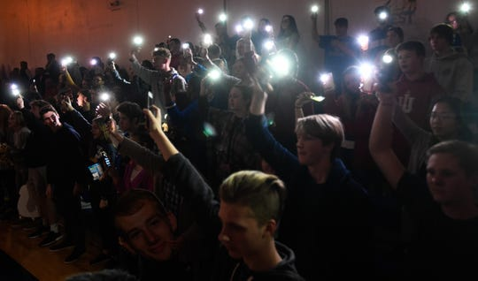 The Eagles student section light up their phones during the player introductions as the Evansville Christian Eagles plays the Washington Catholic Cardinals in Evansville Tuesday evening, January 28, 2020.