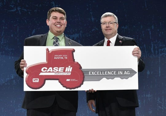 Joe Ankley (left), an agriscience educator and FFA advisor in Port Austin, finished runner-up in the Excellence in Agriculture competition. He will receive a Case IH Farmall 50A tractor, courtesy of Case IH.
