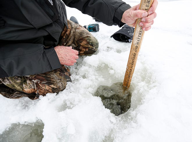 Wayne Blatz of Friendship Fishing Club measures ice thickness Wednesday, Jan. 29, 2020, near Cemetery Road on the west side of Lake Winnebago. Unseasonably warm weather has caused dangerously thin ice over the lake putting a possible halt to car and truck traffic on the lake during sturgeon spearing season.